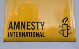 Σημάδι της Διεθνούς Αμνηστίας σε έναν τοίχο στοκ φωτογραφία με δικαίωμα ελεύθερης χρήσης