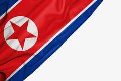Σημαία Βόρεια Κορεών του υφάσματος με το copyspace για το κείμενό σας στο άσπρο υπόβαθρο διανυσματική απεικόνιση