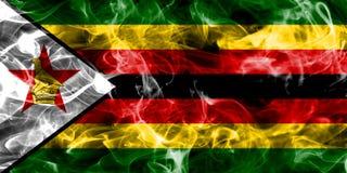 Σημαία καπνού της Ζιμπάμπουε σε ένα μαύρο υπόβαθρο Στοκ Εικόνες