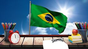 Σημαία της Βραζιλίας με τις σχολικές προμήθειες απόθεμα βίντεο