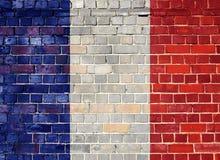 Σημαία της Γαλλίας σε έναν παλαιό τουβλότοιχο Στοκ φωτογραφία με δικαίωμα ελεύθερης χρήσης
