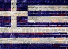 Σημαία της Ελλάδας σε έναν τουβλότοιχο Στοκ φωτογραφία με δικαίωμα ελεύθερης χρήσης