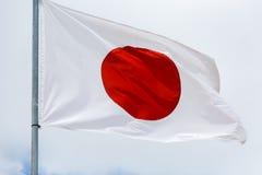 Σημαία της Ιαπωνίας που κυματίζει στον αέρα Στοκ Εικόνες