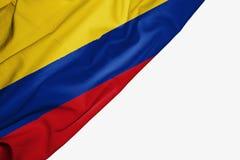 Σημαία της Κολομβίας του υφάσματος με το copyspace για το κείμενό σας στο άσπρο υπόβαθρο απεικόνιση αποθεμάτων
