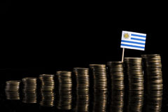 Σημαία της Ουρουγουάης με το μέρος των νομισμάτων στο Μαύρο Στοκ Εικόνες