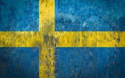 Σημαία της Σουηδίας που χρωματίζεται σε έναν τοίχο Στοκ Φωτογραφίες