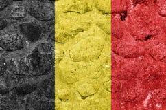 Σημαία του Βελγίου σε ένα walBelgium πετρών απεικόνιση αποθεμάτων