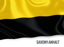 Σημαία του γερμανικού κράτους Σαξωνία-Anhalt που κυματίζει σε ένα απομονωμένο άσπρο υπόβαθρο Στοκ Εικόνα