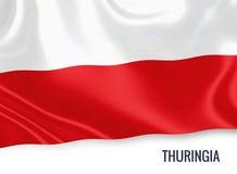 Σημαία του γερμανικού κράτους Thuringia που κυματίζει σε ένα απομονωμένο άσπρο υπόβαθρο Στοκ Εικόνα