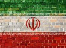 Σημαία του Ιράν σε έναν τουβλότοιχο Στοκ Εικόνα