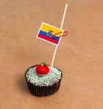 Σημαία του Ισημερινού Apple Cupcake με κόκκινο bonbon μορφής μήλων στην κορυφή Στοκ φωτογραφίες με δικαίωμα ελεύθερης χρήσης