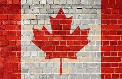 Σημαία του Καναδά σε έναν τουβλότοιχο Στοκ Εικόνες