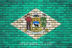 Σημαία του Ντελαγουέρ σε έναν τουβλότοιχο ελεύθερη απεικόνιση δικαιώματος