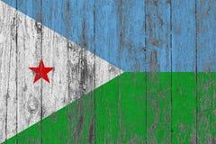Σημαία του Τζιμπουτί που χρωματίζεται στο φθαρμένο ξύλινο υπόβαθρο σύστασης στοκ εικόνα