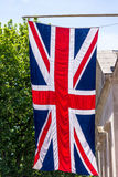 Σημαία του Union Jack που πετά από έναν πόλο σημαιών στην οδό λεωφόρων Λονδίνο Αγγλία Στοκ Εικόνες