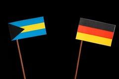 Σημαία των Μπαχαμών με τη γερμανική σημαία στο Μαύρο Στοκ Εικόνα