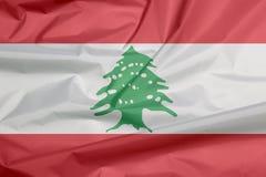 Σημαία υφάσματος του Λιβάνου Πτυχή του λιβανέζικου υποβάθρου σημαιών στοκ φωτογραφία με δικαίωμα ελεύθερης χρήσης