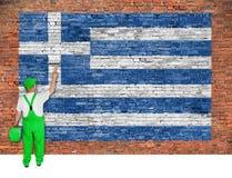 Σημαία χρωμάτων ζωγράφων σπιτιών της Ελλάδας στο τουβλότοιχο στοκ φωτογραφία με δικαίωμα ελεύθερης χρήσης