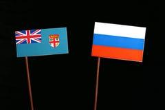 Σημαία Fijian τη ρωσική σημαία που απομονώνεται με στο Μαύρο στοκ εικόνα με δικαίωμα ελεύθερης χρήσης