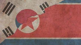 Σημαίες Βόρεια Κορεών και της Νότιας Κορέας στο σκυρόδεμα Στοκ φωτογραφία με δικαίωμα ελεύθερης χρήσης