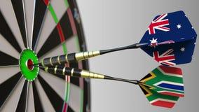 Σημαίες της Αυστραλίας και της Νότιας Αφρικής στα βέλη που χτυπούν bullseye του στόχου Διεθνής συνεργασία ή ανταγωνισμός Στοκ Φωτογραφίες