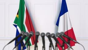 Σημαίες της Νότιας Αφρικής και της Γαλλίας στη διεθνή συνεδρίαση ή τη διάσκεψη τρισδιάστατη απόδοση Στοκ φωτογραφίες με δικαίωμα ελεύθερης χρήσης