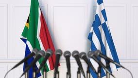 Σημαίες της Νότιας Αφρικής και της Ελλάδας στη διεθνή συνεδρίαση ή τη διάσκεψη τρισδιάστατη απόδοση Στοκ Εικόνες