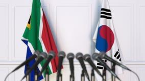 Σημαίες της Νότιας Αφρικής και της Κορέας στη διεθνή συνεδρίαση ή τη διάσκεψη τρισδιάστατη απόδοση Στοκ Φωτογραφία