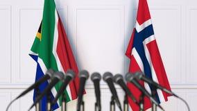 Σημαίες της Νότιας Αφρικής και της Νορβηγίας στη διεθνή συνεδρίαση ή τη διάσκεψη τρισδιάστατη απόδοση Στοκ Φωτογραφίες