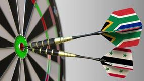 Σημαίες της Νότιας Αφρικής και της Συρίας στα βέλη που χτυπούν bullseye του στόχου Διεθνής συνεργασία ή ανταγωνισμός Στοκ φωτογραφία με δικαίωμα ελεύθερης χρήσης