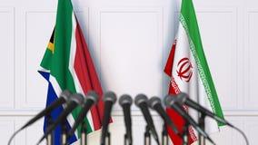 Σημαίες της Νότιας Αφρικής και του Ιράν στη διεθνή συνεδρίαση ή τη διάσκεψη τρισδιάστατη απόδοση Στοκ φωτογραφία με δικαίωμα ελεύθερης χρήσης