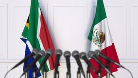 Σημαίες της Νότιας Αφρικής και του Μεξικού στη διεθνή συνεδρίαση ή τη διάσκεψη τρισδιάστατη απόδοση Στοκ Εικόνες
