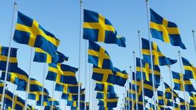 Σημαίες της Σουηδίας που κυματίζουν στον αέρα Στοκ Εικόνες