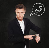 Σημεία επιχειρηματιών στο ρολόι, χρόνος να καλέσει Στοκ Εικόνα