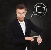 Σημεία επιχειρηματιών στο ρολόι, χρόνος να καλέσει Στοκ Εικόνες