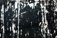 Σημεία του άσπρου χρώματος σε έναν μαύρο τοίχο Στοκ Εικόνες