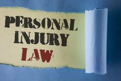 Σημείωση γραψίματος που παρουσιάζει νόμο προσωπικών τραυματισμών Εγγύηση επίδειξης επιχειρησιακών φωτογραφιών τα δικαιώματά σας σ Στοκ Εικόνες