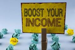 Σημείωση γραψίματος που παρουσιάζει στην ώθηση εισόδημά σας Η επίδειξη επιχειρησιακών φωτογραφιών βελτιώνει την πληρωμή σας Freel στοκ εικόνες