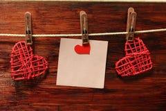 Σημείωση και δύο καρδιές Στοκ Εικόνες