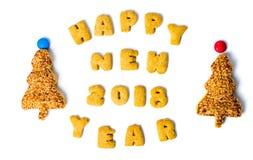 Σημείωση καλής χρονιάς που γράφεται με τα μπισκότα Στοκ εικόνες με δικαίωμα ελεύθερης χρήσης