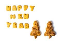 Σημείωση καλής χρονιάς που γράφεται με τα μπισκότα Στοκ φωτογραφία με δικαίωμα ελεύθερης χρήσης