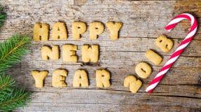 Σημείωση καλής χρονιάς που γράφεται με τα μπισκότα Στοκ Φωτογραφία