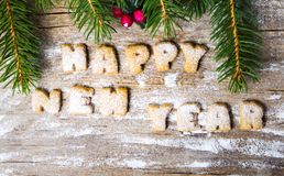 Σημείωση καλής χρονιάς που γράφεται με τα μπισκότα Στοκ φωτογραφίες με δικαίωμα ελεύθερης χρήσης