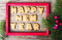 Σημείωση καλής χρονιάς σε ένα ξύλινο πλαίσιο Στοκ Φωτογραφία