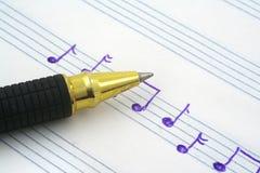σημείωση μουσικής χεριών γραπτή Στοκ εικόνα με δικαίωμα ελεύθερης χρήσης