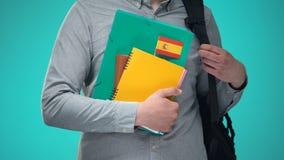 Σημειωματάρια εκμετάλλευσης σπουδαστών με την ισπανική σημαία, διεθνές εκπαιδευτικό πρόγραμμα απόθεμα βίντεο