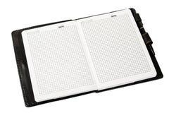Σημειωματάριο ή ημερολόγιο με τις κενές σελίδες, το λευκό και τη μάνδρα σε μια λευκιά ΤΣΕ Στοκ Φωτογραφίες