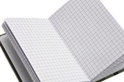 Σημειωματάριο για τις καθημερινές σημειώσεις και τις σημειώσεις για ένα άσπρο υπόβαθρο στοκ φωτογραφία