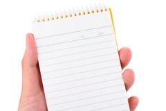 σημειωματάριο εκμετάλλευσης χεριών Στοκ Εικόνες