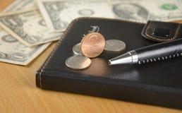 Σημειωματάριο και αμερικανικό νόμισμα Στοκ εικόνα με δικαίωμα ελεύθερης χρήσης